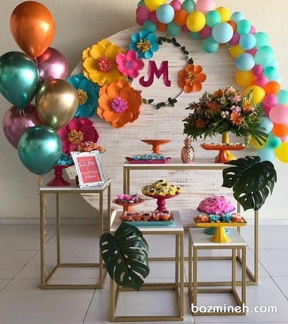 دیزاین جشن تولد دخترانه با بادکنک و گلهای کاغذی