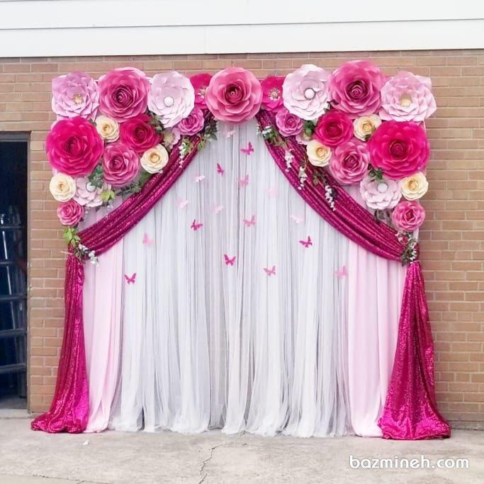 دیزاین جشن تولد دخترونه با تم گل و پروانه کاغذی و تم رنگی سفید صورتی